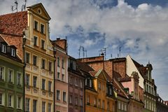 Colorful historic buildings with dramatic sky in Wroclaw, Poland. royalty free stock photography