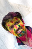 Colorful Holi. A man with his face traditionally smeared with colors during the traditional holi festival in India Stock Photography