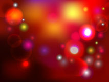 Colorful holiday background with lights and spackles. Colorful red holiday background with lights and sparkles Royalty Free Stock Photo