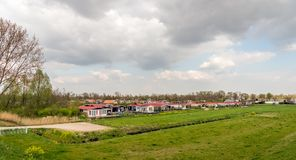 Cottages in a Dutch polder area. Colorful holiday bungalows in the Dutch village of Hank, North Brabant Stock Photo
