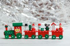 A colorful holiday Christmas train over a white background Stock Photos
