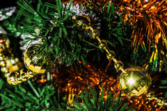 Colorful holiday design. Of a Christmas tree, tinsel and balls Stock Images