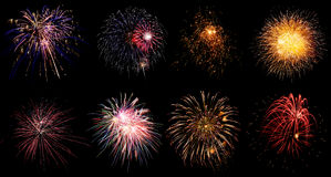 Colorful holiday fireworks on black sky background Stock Photo