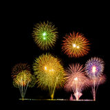 Colorful holiday fireworks in the night sky royalty free stock photography