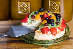 Colorful Holiday Fruit Tart. With one slice taken out of it Royalty Free Stock Photos