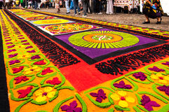Colorful Holy Week carpet in Antigua, Guatemala. ANTIGUA, GUATEMALA - APRIL 17, 2011: Holy Week carpet (or alfombra) made in the path of religious processions stock photography