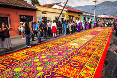 Colorful Holy Week carpet in Antigua, Guatemala. ANTIGUA, GUATEMALA - APRIL 6, 2012: Holy Week carpet (or alfombra) made using wooden stencils and dyed sawdust stock images