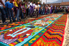 Colorful Holy Week carpet in Antigua, Guatemala. ANTIGUA, GUATEMALA - APRIL 1, 2012: Mayan design Holy Week carpet (or alfombra) made in the path of a religious royalty free stock images