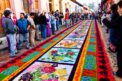 Colorful Holy Week carpet in Antigua, Guatemala. ANTIGUA, GUATEMALA - ARPIL 10, 2009: Holy Week carpet (or alfombra) made in the path of a religious procession royalty free stock photo