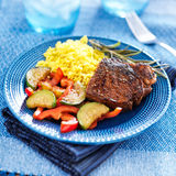 Colorful homecooked steak dinner with vegetables Stock Photography