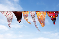Colorful homemade bunting triangular flags hanging against a sun Royalty Free Stock Image
