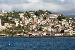 Colorful Homes on Martinique Coast with Green Channel Marker Stock Photography