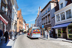 Colorful Hop on hop off Sightseeing City Tours bus in Bruges, Belgium Royalty Free Stock Photos
