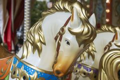 Colorful horse head on a vintage circular merry-go-round stock image