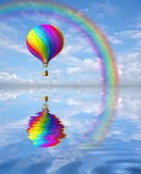 Colorful hot air ballon in the blue sky with rainbow. 3d colorful Hot Air Balloon and rainbow in the blue sky and reflection in water Stock Photos