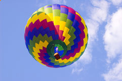Colorful Hot Air Balloon. Photo looking up at a colorful hot air balloon with clouds in the sky Royalty Free Stock Images