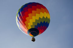 Colorful hot air balloon. In blue summer sky Stock Photography