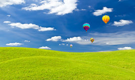 Colorful hot air balloon against blue sky Stock Photo