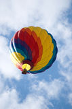 Colorful Hot Air Balloon. Against a partly cloudy sky Royalty Free Stock Images