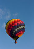 Colorful Hot Air Balloon. In a blue sky Stock Images