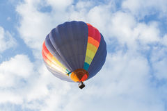 Colorful hot air balloon. On blue sky Royalty Free Stock Images