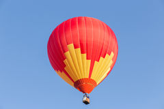 Colorful hot air balloon. On blue sky Stock Image