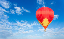 Colorful hot air balloon. On blue sky Royalty Free Stock Photo