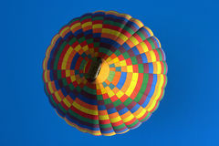 Colorful hot-air balloon. On blue sky background Royalty Free Stock Photo