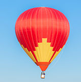 Colorful hot air balloon. On blue sky background Stock Photo