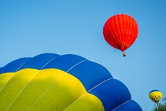 Colorful hot air balloon on a blue sky background Stock Photography