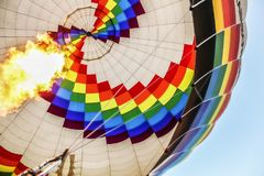 Colorful hot air balloon on blue sky background stock images