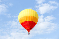 Colorful hot air balloon. On clouds blue sky Royalty Free Stock Images