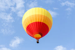 Colorful hot air balloon. On clouds blue sky Royalty Free Stock Photography