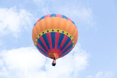 Colorful hot air balloon. On clouds blue sky Royalty Free Stock Image