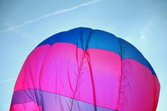 Colorful hot air balloon flies Royalty Free Stock Photo