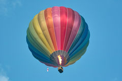 Colorful hot air balloon in flight. Propane burner in operation for up to an altitude of the balloon stock photos