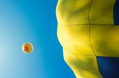 Colorful hot air balloon flying in the blue sky.  stock image