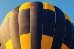 Colorful hot air balloon flying in the blue sky.  stock photo