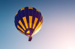 Colorful hot air balloon flying in the blue sky.  royalty free stock photos
