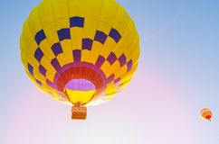 Colorful hot air balloon flying in the blue sky.  royalty free stock photography