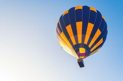 Colorful hot air balloon flying in the blue sky.  stock photos
