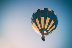 Colorful hot air balloon flying in the blue sky.  royalty free stock images