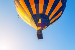 Colorful hot air balloon flying in the blue sky.  royalty free stock image