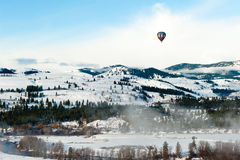 Colorful Hot Air Balloon Flying in the Blue Sky ov Stock Photo