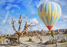 Colorful hot air balloon flying over the valley at Cappadocia Royalty Free Stock Image