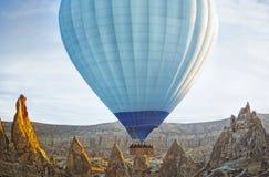 Colorful hot air balloon flying over the valley at Cappadocia Royalty Free Stock Photos
