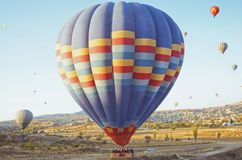 Colorful hot air balloon flying over the valley at Cappadocia Stock Images