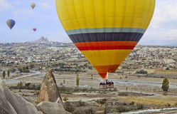 Colorful hot air balloon flying over the valley at Cappadocia Royalty Free Stock Photo