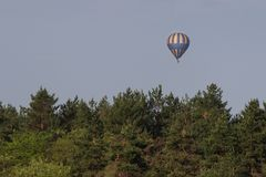 Colorful hot air balloon flying on sky. travel and air transportation concept.  royalty free stock photography