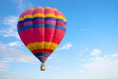 Colorful hot air balloon flying on sky. Stock Images